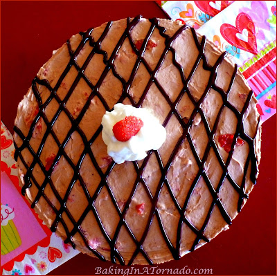 Strawberry Hot Fudge Pie, A fluffy refrigerator pie made with fresh strawberries and hot fudge sauce. Grab a plate and two forks, perfect for sharing with your valentine. | Recipe developed by www.BakingInATornado.com | #recipe #chocolate #pie #ValentinesDay