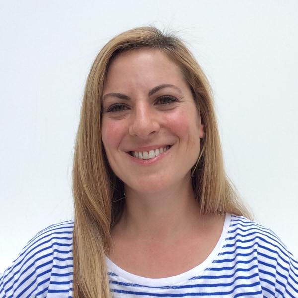 Headshot of Marina in a Striped T-shirt