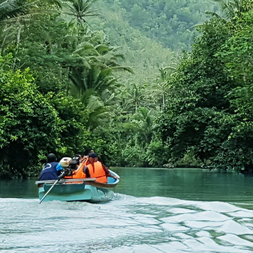 Tinuku Travel Maron River boating along green panorama Sewu Mountains up to Ngiroboyo beach on Indian Ocean coast