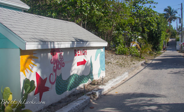 Painted mermaid points to the beach, Great Guana, Abacos
