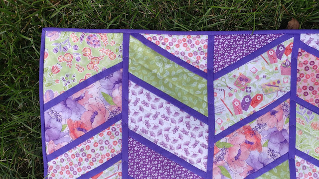 Split Arrows chevron baby quilt in pink and purple fabrics with minky backing