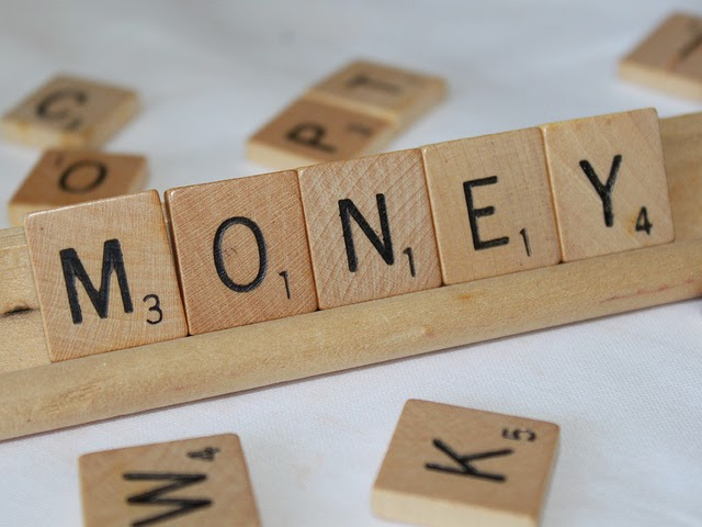 money in wooden letters