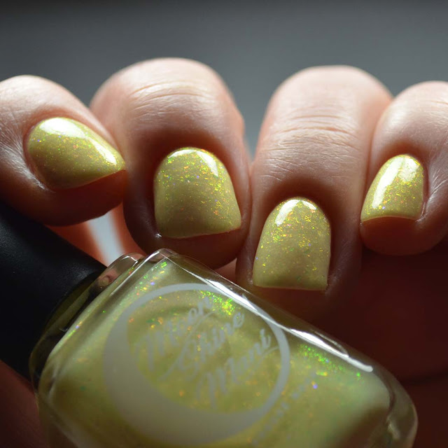 yellow nail polish with pink to green shimmer swatch