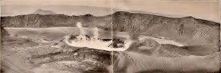 Panoramic view of the whole crater of Taal Volcano on March 4, 1907.  The crater active in the eruption of July 4, 1904, and full of water on December 31, 1905, is now seen to be dry and totally inactive.  The boiling crater lake is increased in area, while the green lake has decreased in size.  A new disturbance seems to be breaking out to the left of the boiling crater lake.