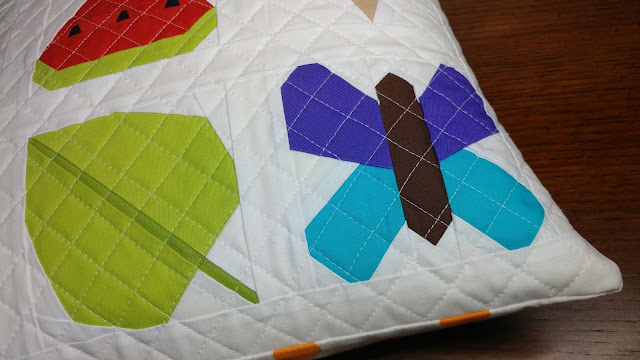 Paper pieced butterfly and leaf quilt blocks