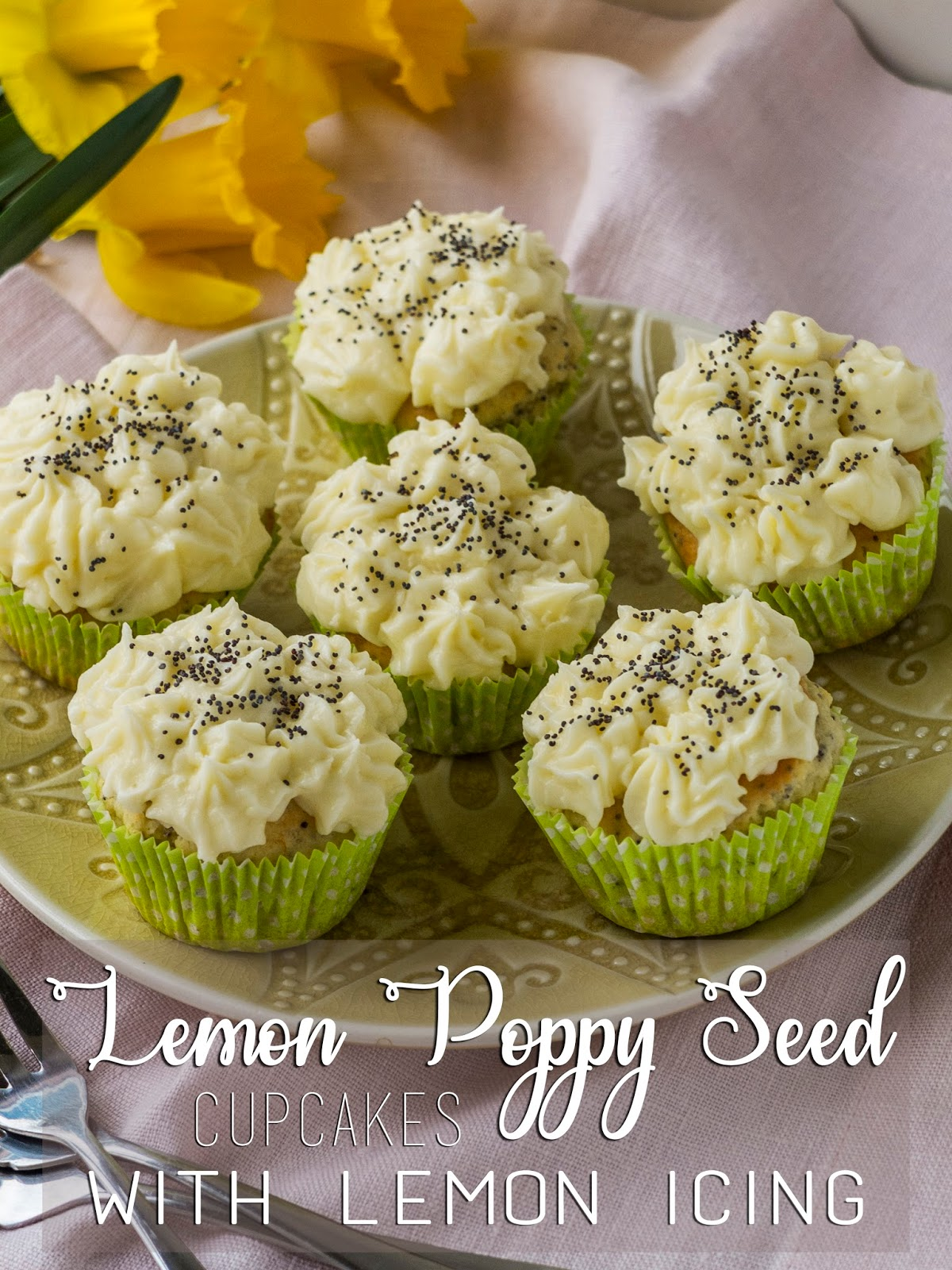 Iced lemon cupcakes arranged on a plate.