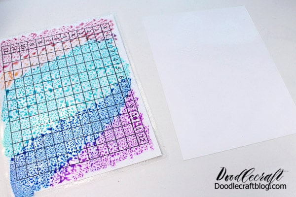 Spray the glossy surface of the photo paper as well.