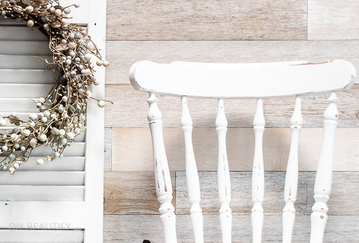 white painted chair and wood wall