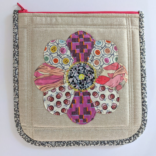 Liberty fabric epp dresden plate flower applique on zipper pouch with binded curved edges and pink zipper