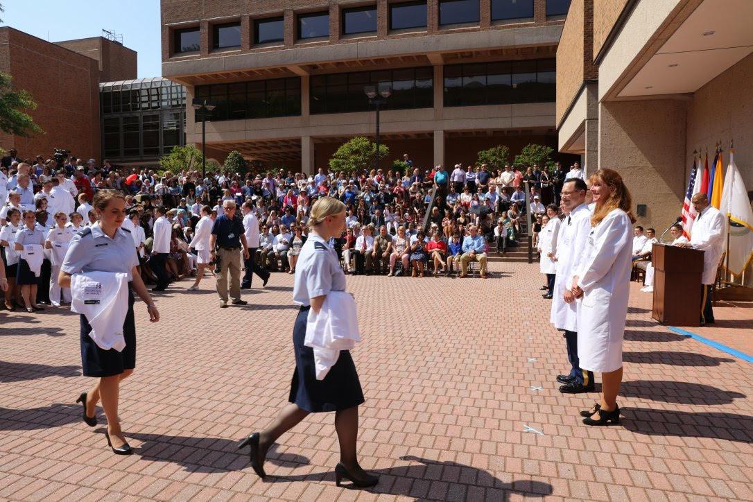 Students walking through the white coat ceremony