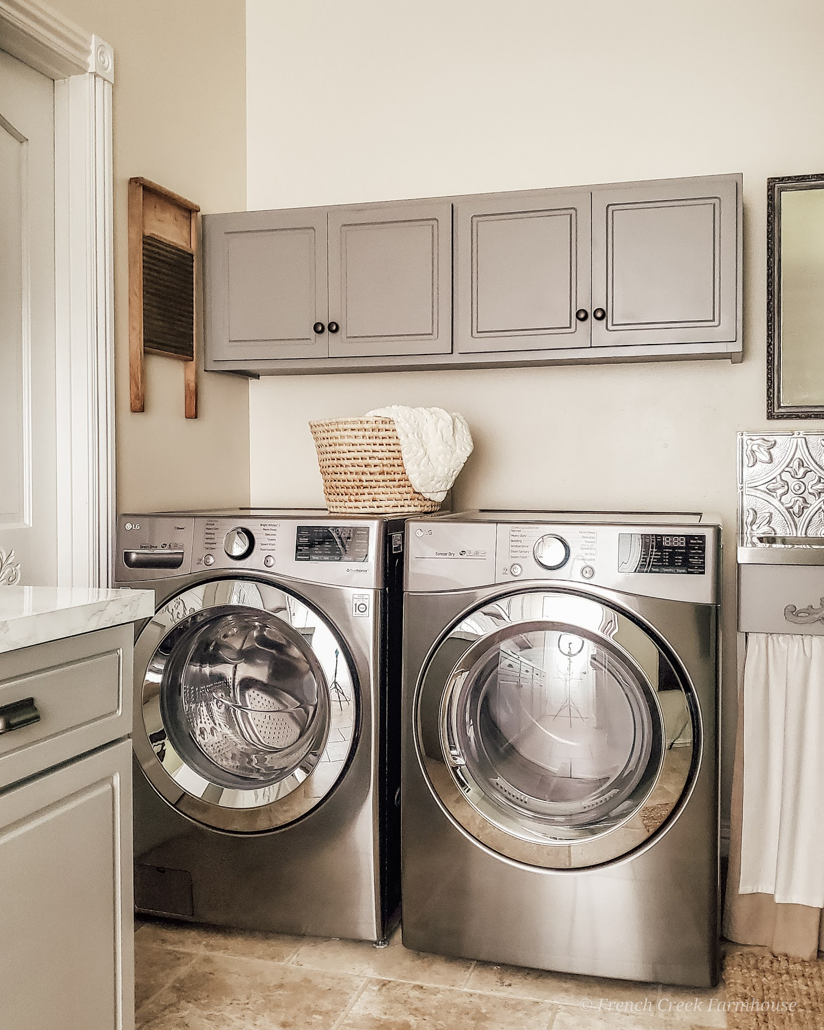 Decorating with vintage items adds a true farmhouse feeling to our laundry room