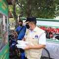 Ditengah Penegakan Aturan PPKM, Satpol PP Kota Tangerang Bagikan Ratusan Paket Makanan