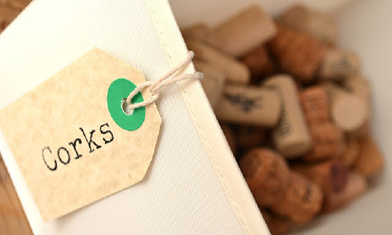 container with corks and a tag