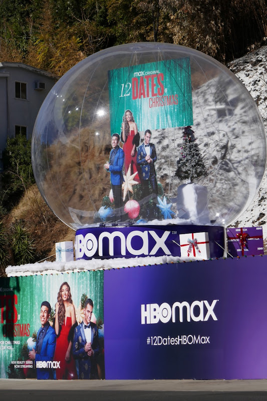 Giant 12 Dates of Christmas snow globe installation