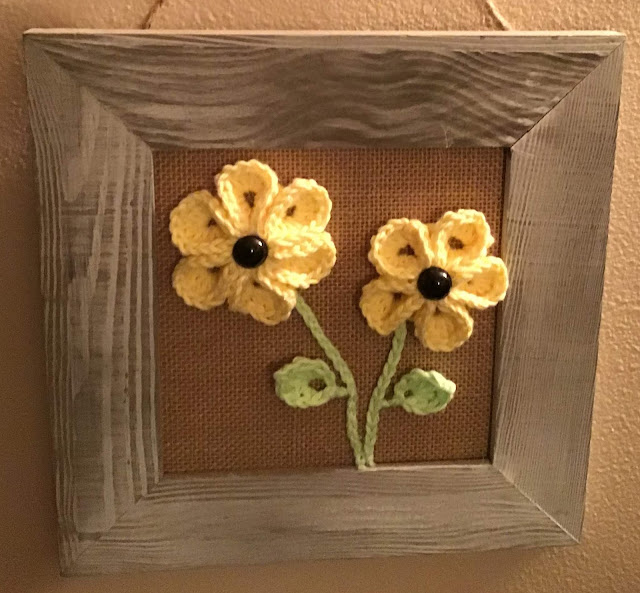 gift of a crochet flower that is framed