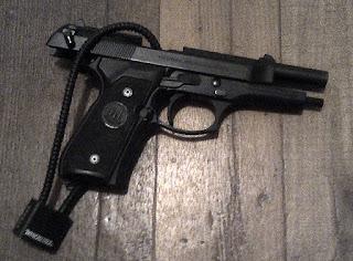 photo of gun and lock with caption Pro Gun Control Arguments vs Anti Gun Control Arguments