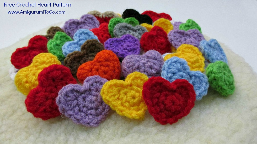 pile of colorful crochet hearts