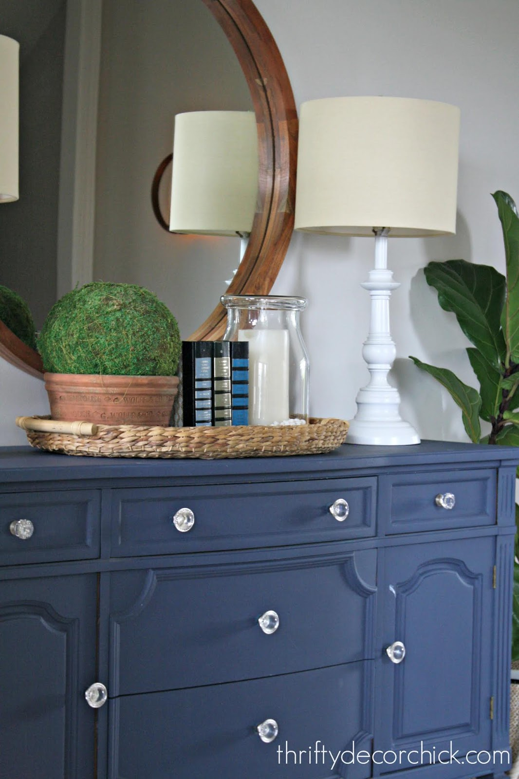 Dark blue dresser white lamps