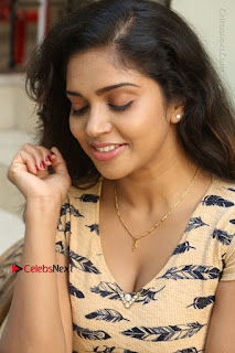 Telugu Actress Karunya Chowdary Stills in Short Dress at ATM Not Working Press Meet  0114.jpg
