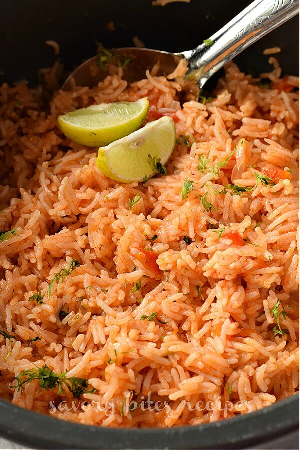 cilantro chopped on mexican rice in a pot