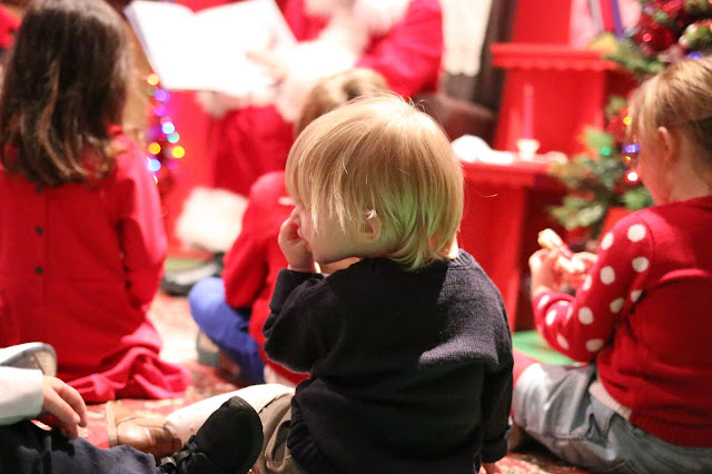 Santa reading to the children at Hamleys Christmas party in Cardiff store