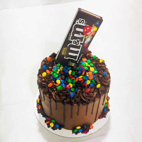 Candy-filled M&Ms Cake - Easy M&Ms cake chocolate cake filled with M&Ms candy and topped with a M&Ms box for a cool anti-gravity effect!