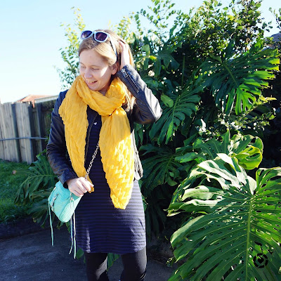 awayfromtheblue Instagram | mustard scarf, navy stripe tee dress leather jacket and aqua mini mac bag winter colourful accessories