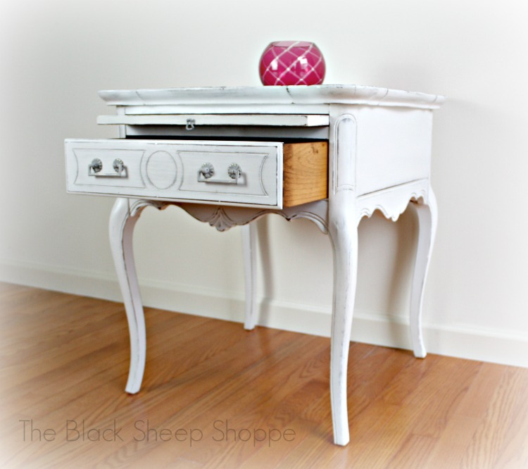Side table with drawer and tray.