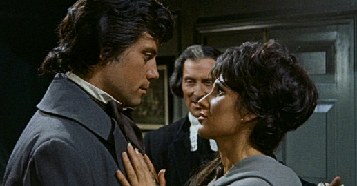 Oliver Reed and Yvonne Romain in Night Creatures, 1962