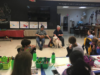 Laurel with Audrey and Audrey's guide dog Jessie, talking to summer day campers