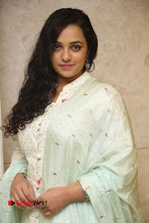 Nithya Menen Latest Pictures in White Dress at 100 Days of Love Movie Audio Launch ~ Celebs Next