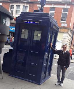 Me next to Tardis Police Box in Kensington, London
