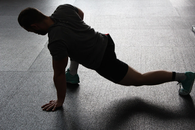 Man stretching, fitness challenge