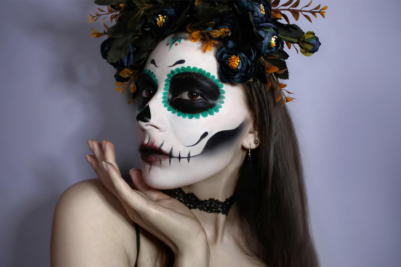 woman wearing a sugar skull inspired halloween makeup look