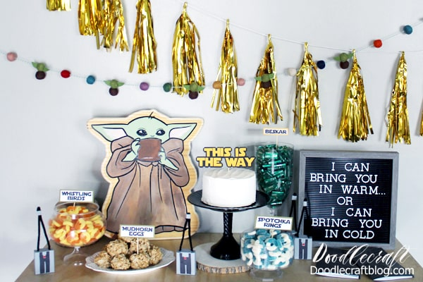 Mando inspired birthday party with baby yoda, mudhorn eggs, splotchka, and whistling birds...plus take home favors made with paper. Perfect star wars themed geek party.