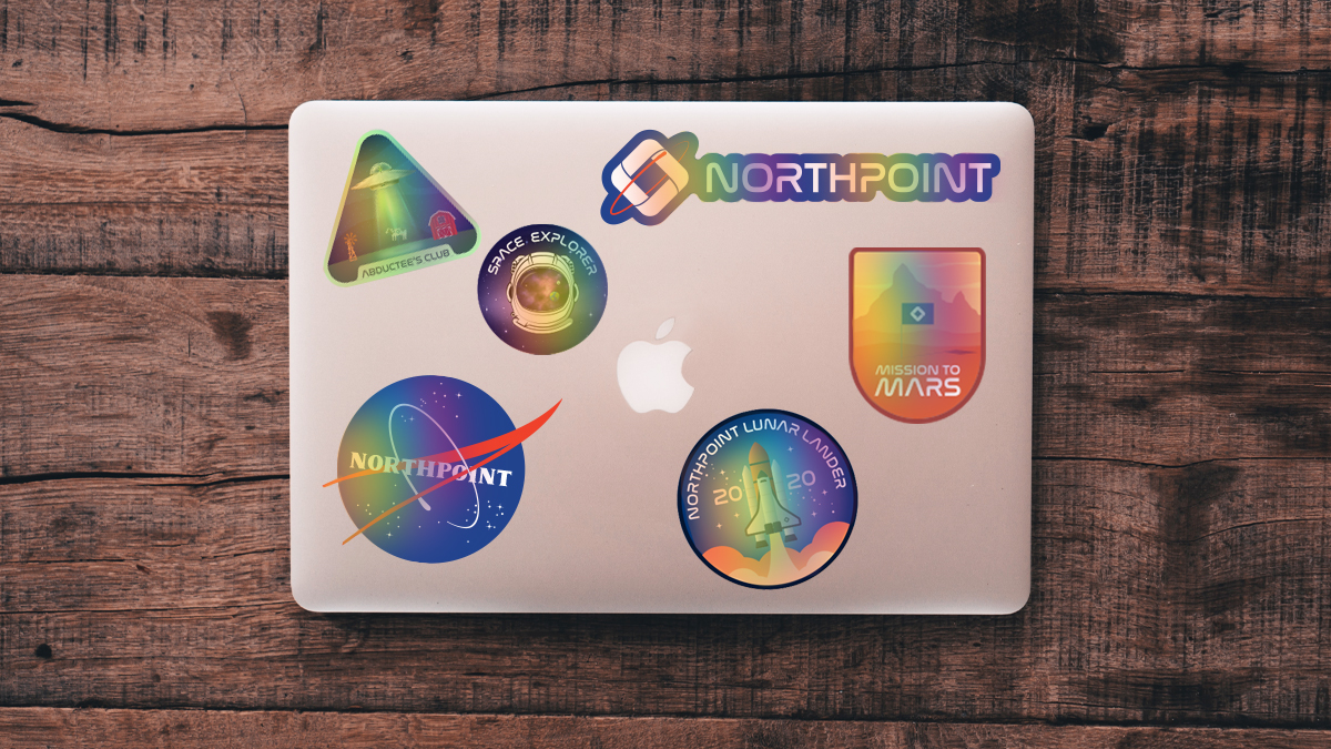 Multi colored stickers on the back of a laptop.