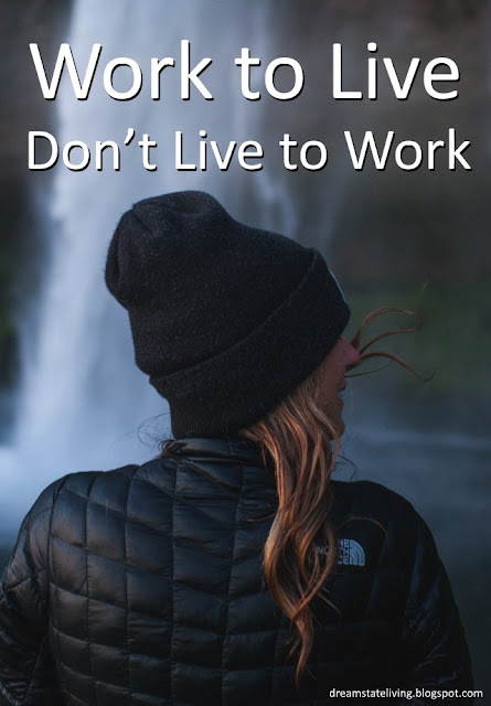 woman dressed in black jacket and black cap seemingly happy with life