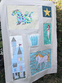 Land of Magic quilt top with fairytale foundation paper pieced blocks between sashing, Kidgiddy quilt pattern