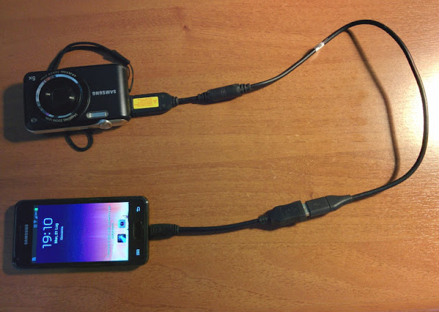 fotocamera collegata con cavo OTG