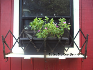 antique model T luggage rack flower box