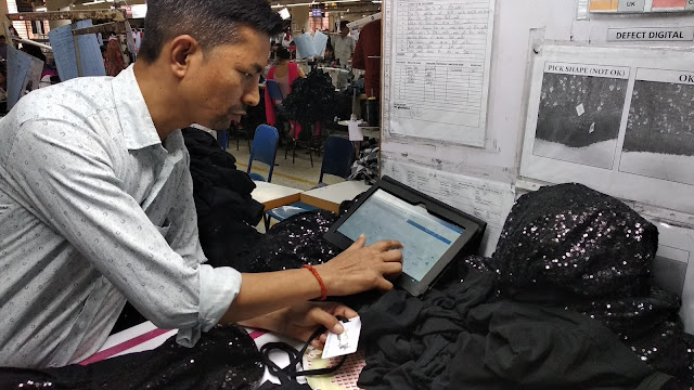 Capturing garment inspection data using quality control application