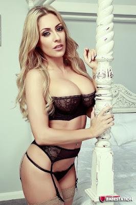 Ashley Emma sexy big boobs side pose black stockings