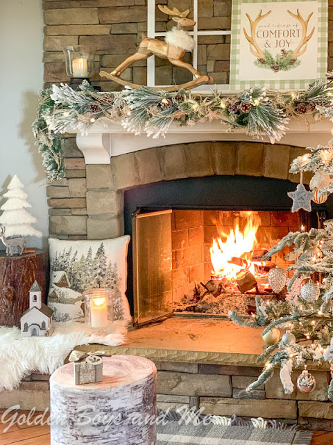 Family room with stone fireplace and neutral decor - www.goldenboysandme.com
