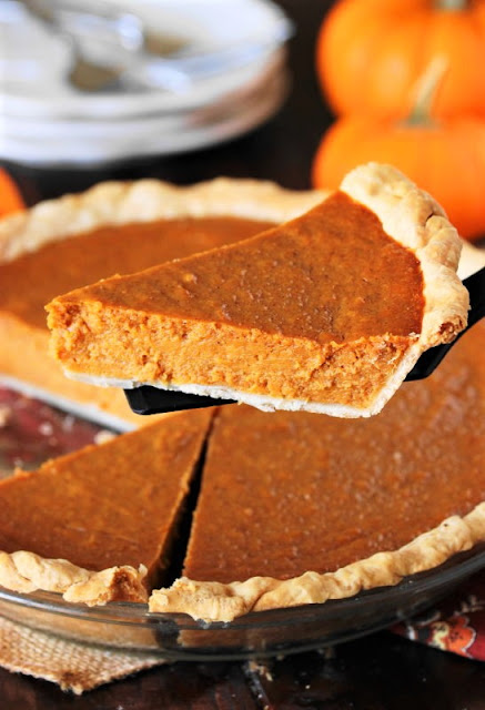 Serving a Slice of Sweet Potato Pumpkin Pie Image