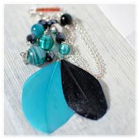 sautoir plumes noir et turquoise