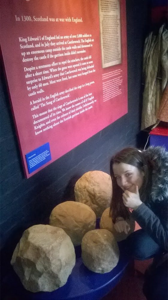 Photo: Barbara's daughter examining the missiles which collided with Castle Caerlaverock during the real life siege battle.