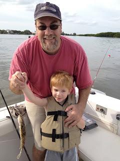 A photo of David Brodosi and his son fishing