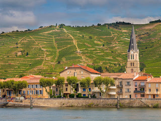 Tournon sur Rhone river town and vineyards on the hills of the Côtes du Rhône