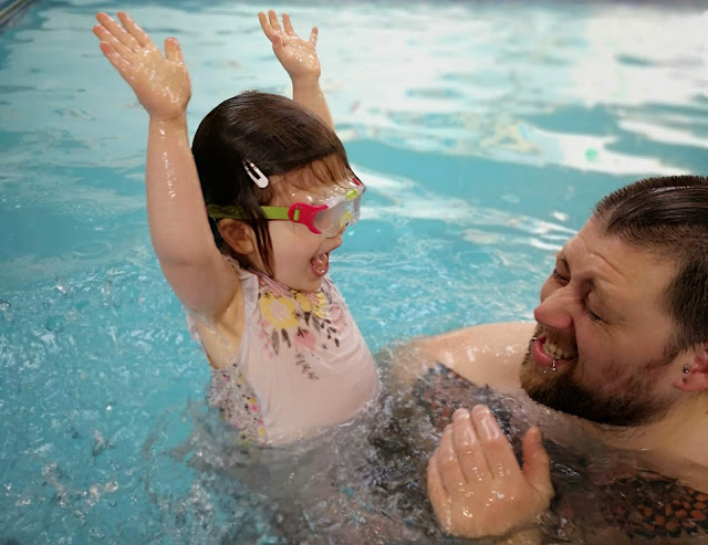 A photo of a swimming lesson for a feature on overcoming water wobbles