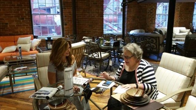 Cute  of Inspiring Designs helps two of the attendees Marcia Daniel and Julia Griffin select fabrics and colors for their outdoor furniture selection